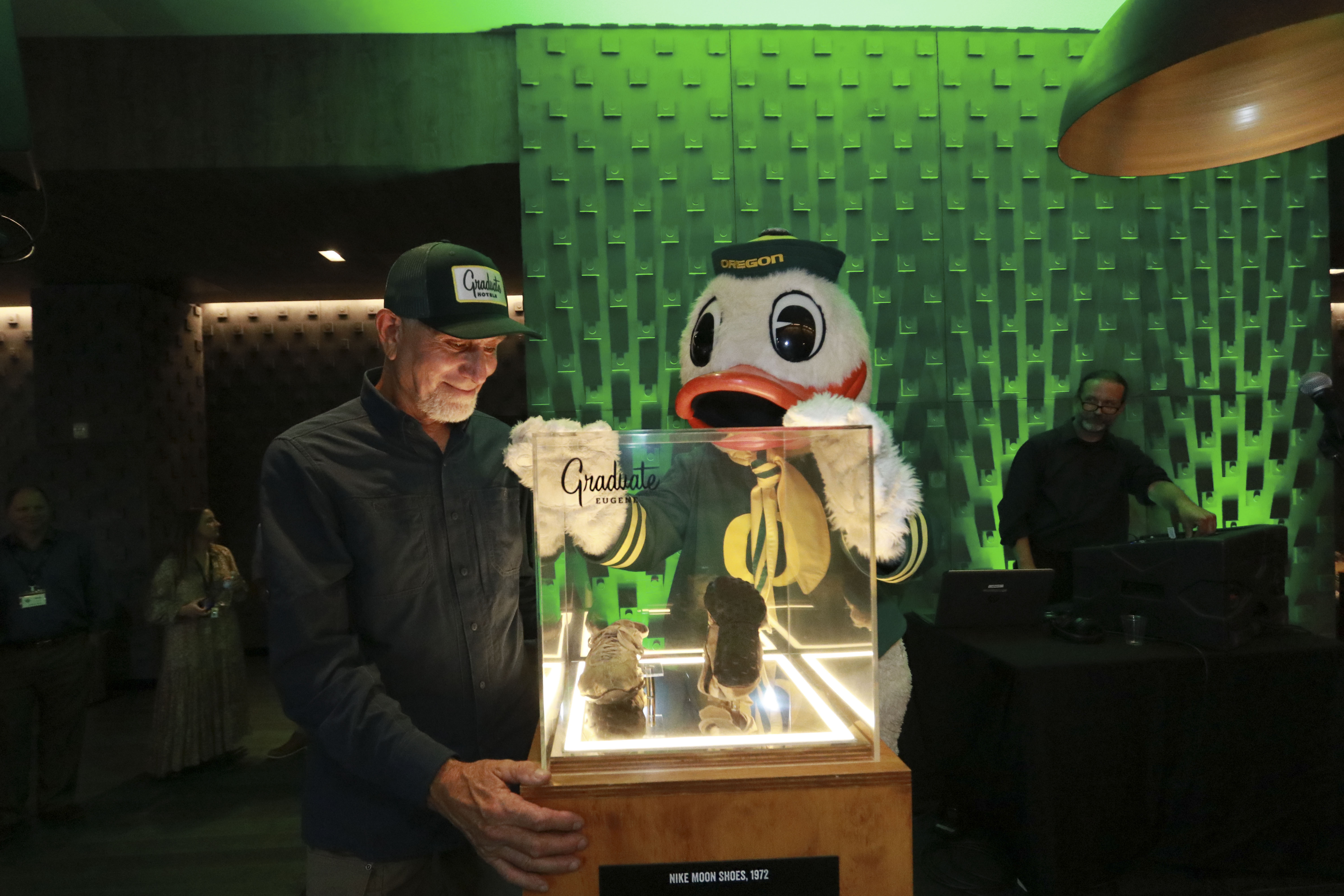 David Russell and the Oregon Duck unveil the Moon Shoes during an event at Graduate Eugene.