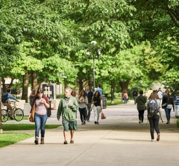 students walking through a college campus